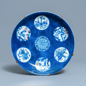 A Chinese blue, white and copper-red powder-blue-ground dish, Kangxi