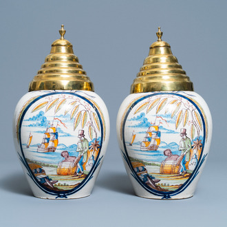 A pair of polychrome Dutch Delft tobacco jars with a merchant and a slave, late 18th C.
