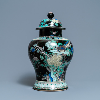 A Chinese famille noire vase and cover, 19th C.