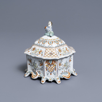 A Dutch Delft polychrome petit feu tobacco box and cover with a seated Chinaman, 18th C.