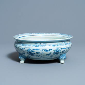 A Chinese blue and white tripod censer with floral design, Ming