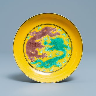 A Chinese yellow-ground green and aubergine 'dragon' dish, Guangxu mark and of the period