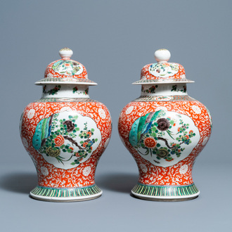 A pair of Chinese famille verte vases and covers, 19/20th C.