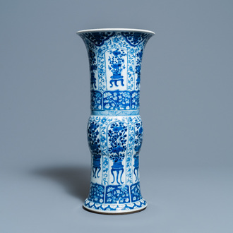 A Chinese blue and white 'gu' vase with flowery jardinières, Kangxi