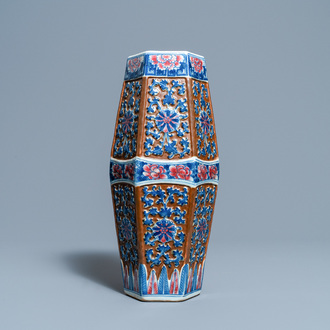 A Chinese hexagonal blue, white and copper-red brown-ground vase, 19th C.