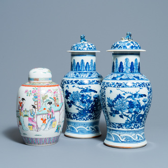 A pair of Chinese blue and white vases and a famille rose jar and cover, 19/20th C.