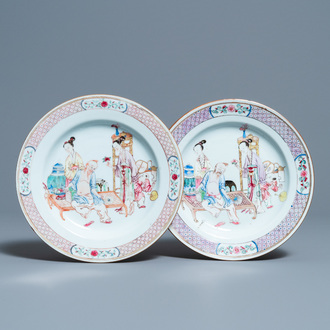 A pair of fine Chinese famille rose ruby back plates with figures in an interior, Yongzheng