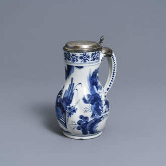 A silver-mounted Dutch Delft blue and white chinoiserie jug, 17th C.