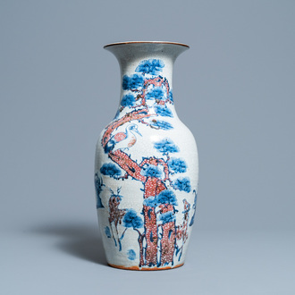 A Chinese blue, white and copper-red 'deer and crane' vase, 19th C.