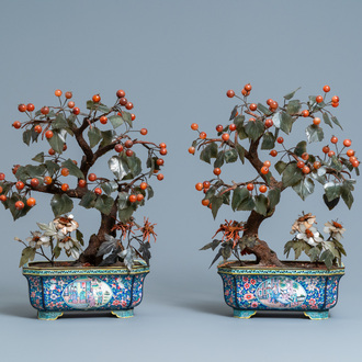 A pair of large Chinese Canton enamel jardinières with jade and hardstone trees, 19th C.