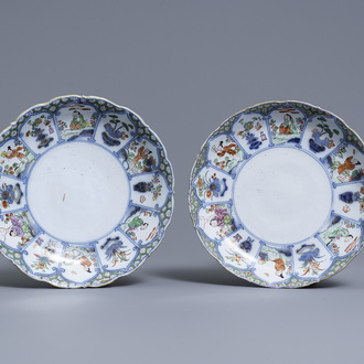 A pair of polychrome petit feu and gilded Dutch Delft famille verte-style chinoiserie plates, 1st quarter 18th C.