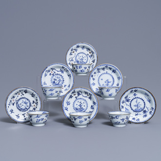 Six Chinese blue, white and copper-red cups and saucers, Kangxi