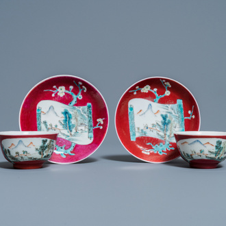 A pair of Chinese famille rose ruby-ground cups and saucers, Yongzheng