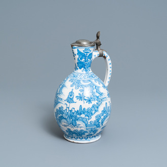 A large Dutch Delft blue and white chinoiserie jug with pewter cover, 17th C.