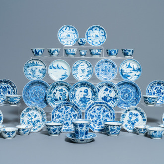 Nineteen Chinese blue and white cups and twenty-one saucers, Kangxi and later