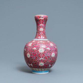 A Chinese famille rose ruby-ground bottle vase, Qianlong mark, 19/20th C.