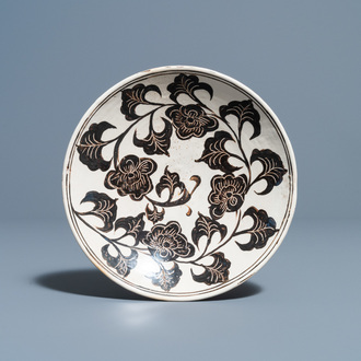 A Chinese Cizhou plate with carved floral design, Song/Ming