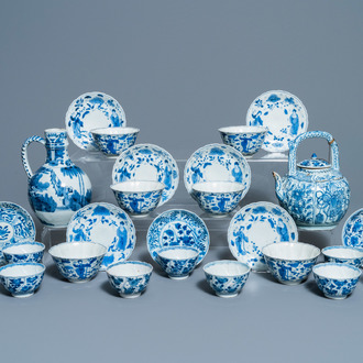 A collection of Chinese and Japanese blue and white cups and saucers and two ewers, Wanli and later