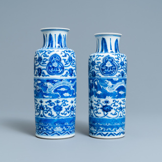 Two Chinese blue and white rouleau vases with horizontal dragon panels, Kangxi