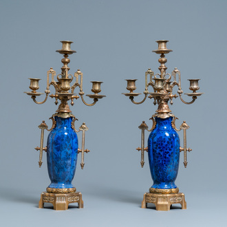 A pair of Chinese blue-ground vases with bronze candelabra mounts, Kangxi and 19th C.