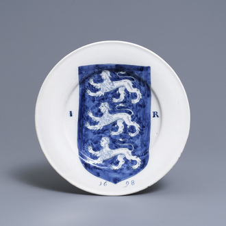 A Dutch Delft blue and white dish with the arms of James I, dated 1698