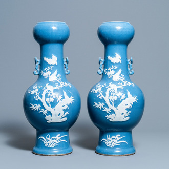 A pair of Chinese white slip-decorated blue-ground vases, 19th C.