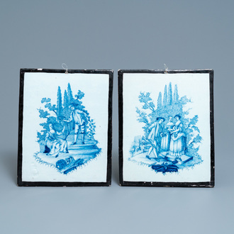 A pair of Dutch Delft blue and white plaques with black borders, 18th C.