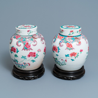 A pair of Chinese famille rose jars and covers with floral design, Qianlong