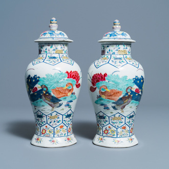 A pair of Chinese famille rose 'mandarin ducks' vases and covers, Kangxi mark, Republic