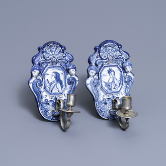 A pair of Dutch Delft blue and white appliques with royalist portraits of prince William IV and princess Anne, 18th C.