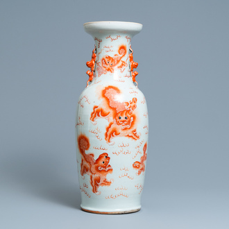 A Chinese iron-red 'Buddhist lion' vase, 19th C.