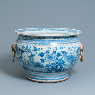 A large Chinese blue and white fishbowl with gilt bronze handles, Qianlong