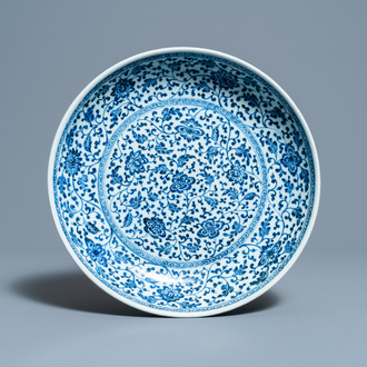 A Chinese Ming-style blue and white 'floral scroll' dish, Qianlong