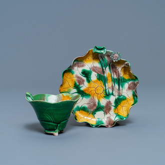 A Chinese 'egg and spinach'-glazed lotus cup and saucer with applied design, Kangxi