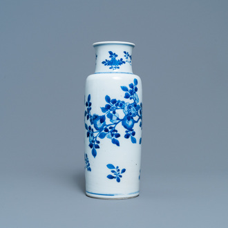 A Chinese blue and white rouleau vase with floral design, Kangxi