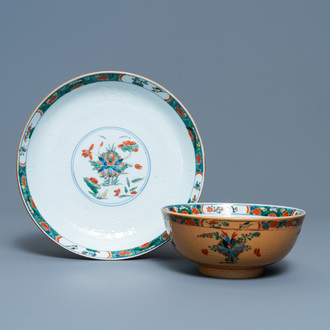 A Chinese capucine brown-ground famille verte plate and a bowl, Kangxi