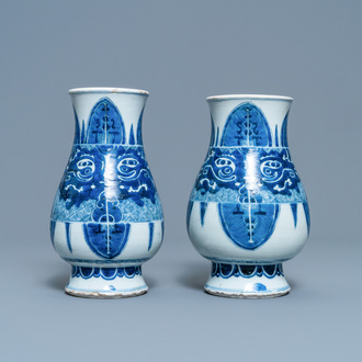 A pair of Chinese blue and white 'taotie' vases, Kangxi