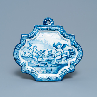 A Dutch Delft blue and white plaque with Venus visited by two putti, 18th C.