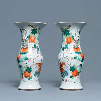 A pair of Chinese famille rose vases with boys hanging near pumpkins, 19th C.