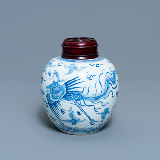 A Chinese blue and white 'dragon and phoenix' jar with wooden lid, Chenghua mark, Kangxi