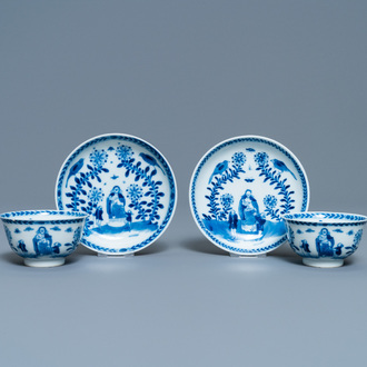 A pair of Chinese blue and white 'Caritas' cups and saucers, Kangxi/Yongzheng