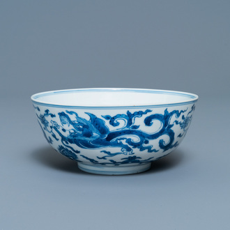 A Chinese blue and white 'dragon' bowl with a double vajra in the centre, Chenghua mark, Kangxi