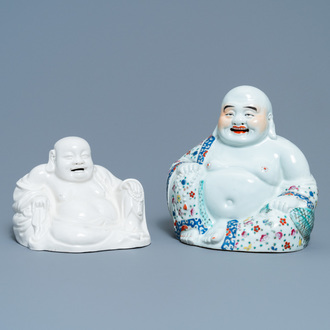 A Chinese famille rose figure of Buddha and one in blanc de Chine, 19/20th C.