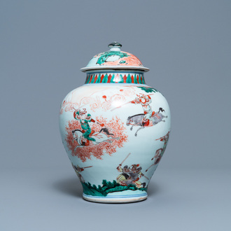 A Chinese famille verte vase and cover with an equestrian battle scene, Kangxi