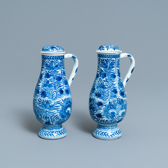 A pair of Chinese blue and white ewers and covers with floral design, Kangxi