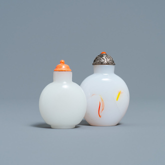 A Chinese white jade coral-topped snuff bottle and one in glass with inclusions, 19th C.