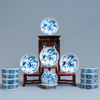 A pair of Chinese blue and white three-tier stacking boxes, a seal paste box and four saucers, 19th C.