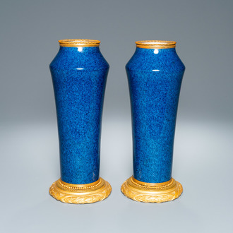A pair of monochome powder blue Sèvres vases with gilded bronze mounts, 19th C.