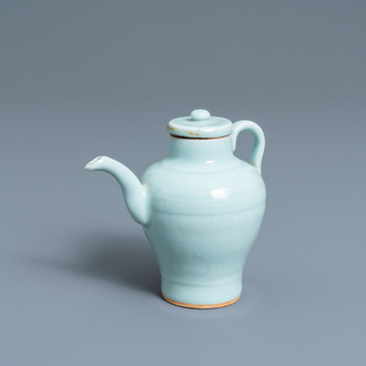 A Chinese monochrome celadon-glazed ewer and cover with incised design, Qianlong