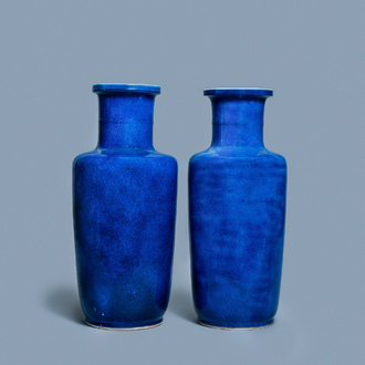 A pair of Chinese monochrome powder blue rouleau vases, Kangxi
